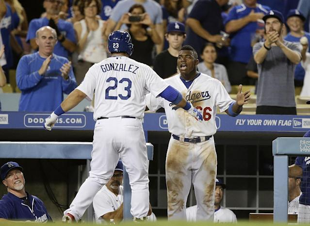 Los Angeles Dodgers' Adrian Gonzalez, left is congratulated by teammate Yasiel Puig after hitting a two-run home run against the San Diego Padres during the seventh inning of a baseball game on Friday, Aug. 30, 2013, in Los Angeles. (AP Photo/Jae C. Hong)