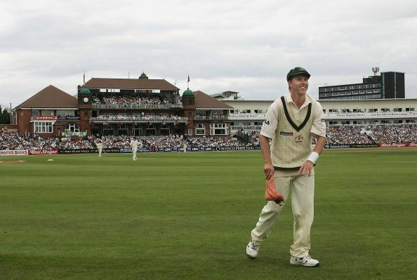 MANCHESTER, UNITED KINGDOM - AUGUST 14: Brett Lee of Australia picks up a fake severed foot thrown on to the field from the crowd during day four of the Third npower Ashes Test between England and Australia played at Old Trafford on August 14, 2005 in Manchester, United Kingdom (Photo by Hamish Blair/Getty Images)