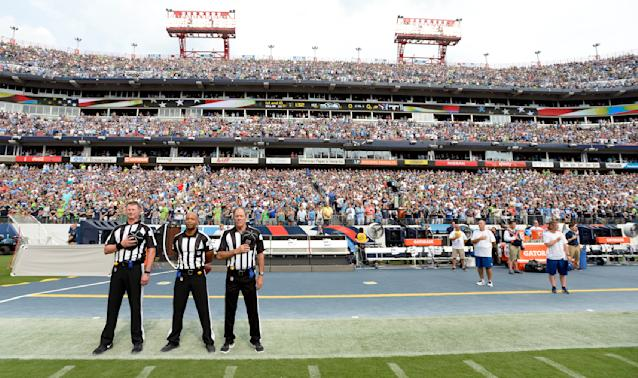 <p>Officials stand on the sideline of the Seattle Seahawks during the playing of the national anthem before an NFL football game between the Seahawks and the Tennessee Titans Sunday, Sept. 24, 2017, in Nashville, Tenn. Neither team came out onto the field for the anthem. (AP Photo/Mark Zaleski) </p>