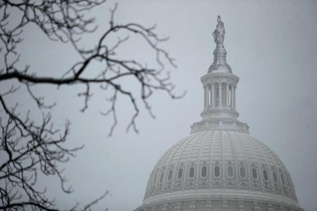 A wet and heavy mixture of rain and snow covers the north side of the bronze Statue of Freedom on the top of the U.S. Capitol Dome March 6, 2013 in Washington, DC. A late winter storm is expected to cover the Mid-Atlantic region after dropping almost a foot of snow across the the West and Midwest. (Photo by Chip Somodevilla/Getty Images)