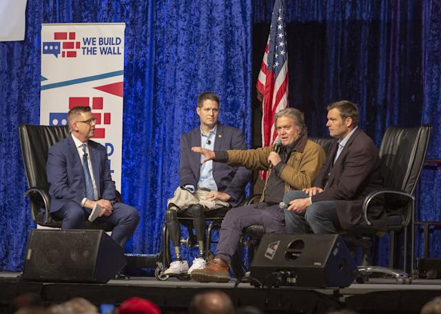 Steve Bannon speaking at an event in March to promote We Build the Wall. With him, from right: former Kansas Secretary of State Kris Kobach, We Build the Wall founder and president Brian Kolfage and Neal McCabe of One America News Network. (Photo: Jim West/ZUMA Wire)