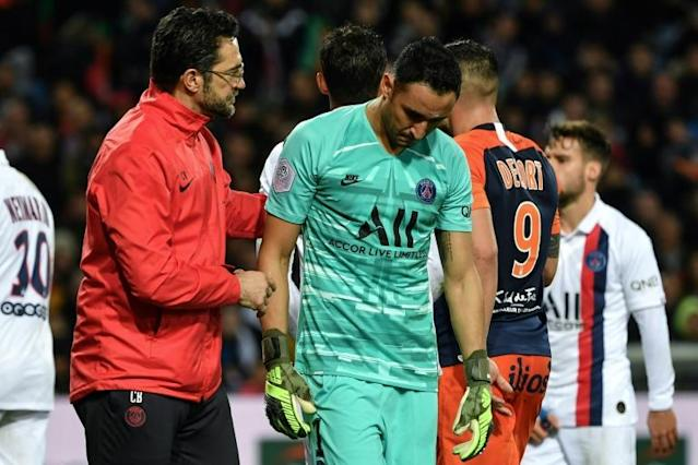 PSG goalkeeper Keylor Navas received medical assistance after he was struck by an object thrown from the stands (AFP Photo/Pascal GUYOT)