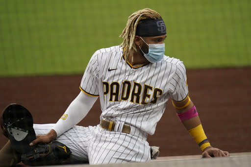 San Diego Padres shortstop Fernando Tatis Jr. wears a mask after hearing that the team's baseball game against the San Francisco Giants had been postponed, Friday, Sept. 11, 2020, in San Diego, minutes before the scheduled first pitch. (AP Photo/Gregory Bull)