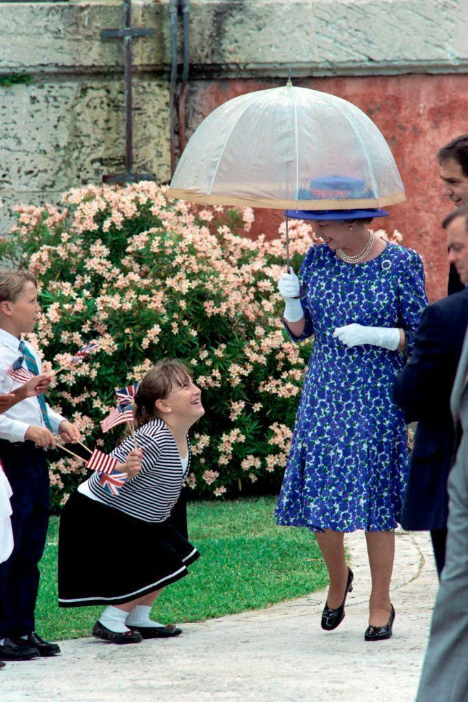 <p>A young fan tries to get in on the Queen's umbrella action.<br></p>