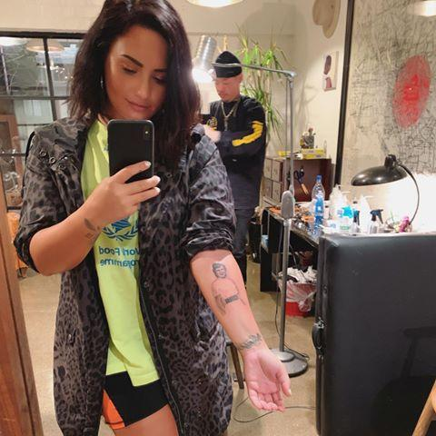"""<p>Lovato honored """"Mimaw,"""" her late great-grandmother, with a portrait on her inner forearm. """"This is for you, Mimaw. You at 26 on my arm while I'm 26, and forever. I love you more. ❤️ Thank you @_dr_woo_ for making her come back to life for me. It's stunning and the most meaningful tattoo I have ever gotten. 🙏🏼🙌🏼,"""" she wrote on Instagram.</p> <p>The piece was based on a photograph of Lovato's grandmother, who died in 2016.</p>"""