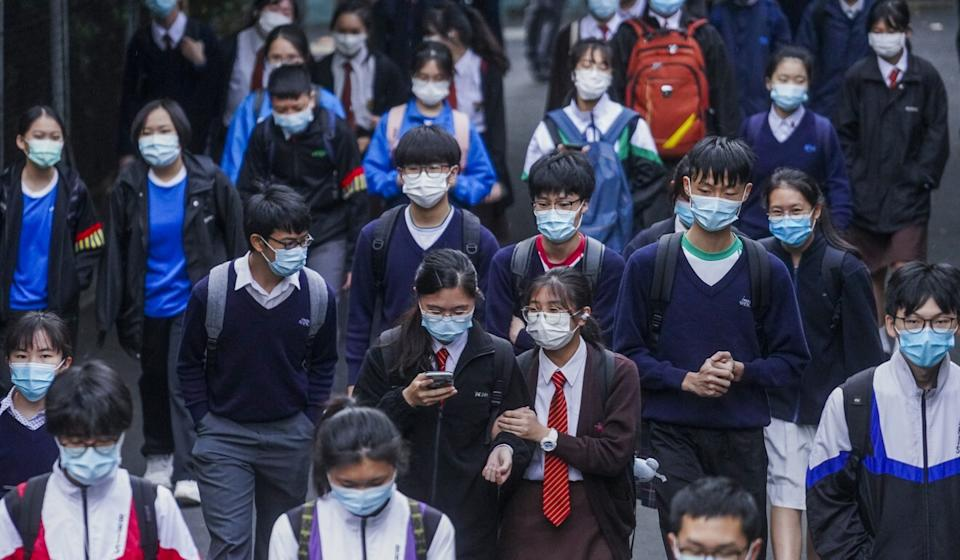 Students wearing protective face masks return to school in Kowloon Tong last November, before the city's fourth wave of Covid-19 infections surged. Photo: Winson Wong