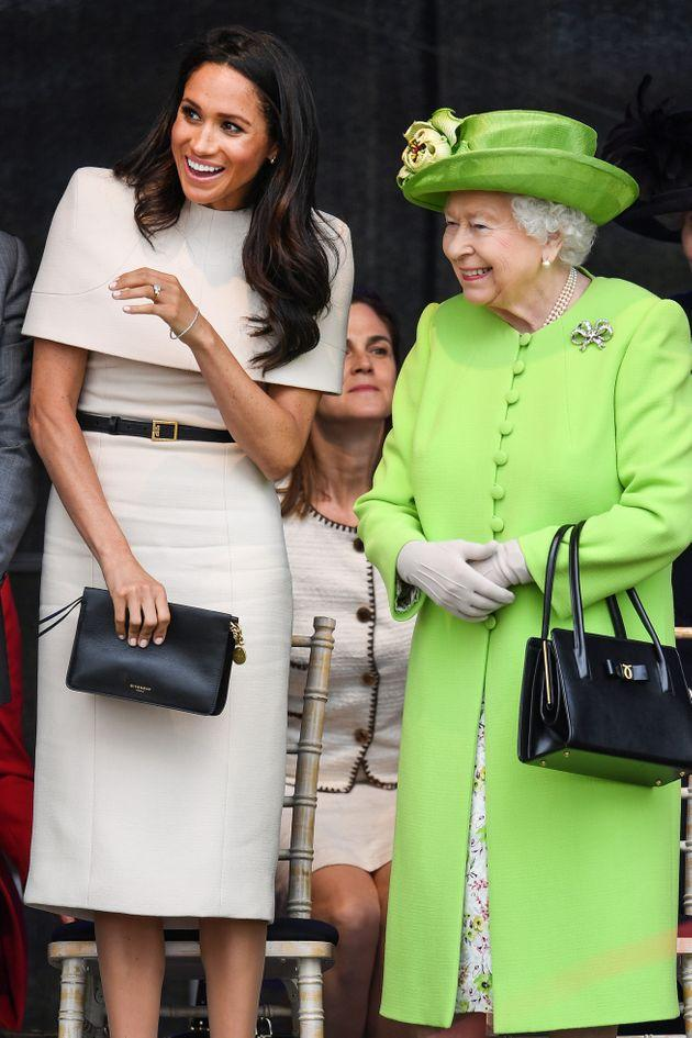 The queen stands with the Duchess of Sussex during a ceremony to open the new Mersey Gateway Bridge on June 14, 2018.