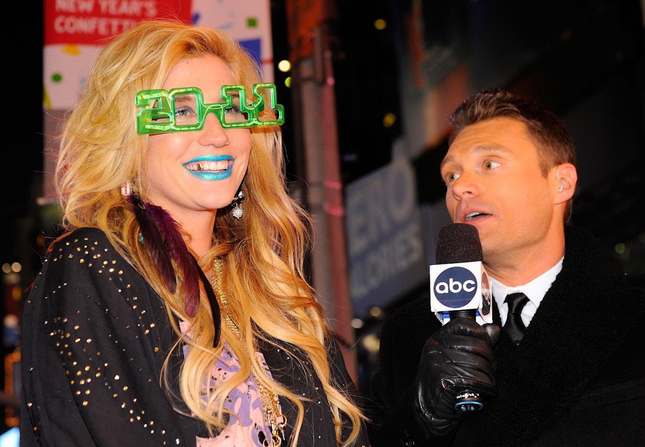 Poor Ryan Seacrest looks a little shocked by Ke$ha's electric blue lips at Dick Clark's New Year's Rockin' Eve in 2011.