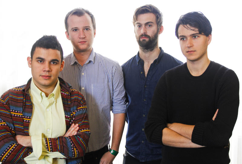"""This March 14, 2013 photo shows members of the band Vampire Weekend, from left, Rostam Batmanglij, Chris Baio, Chris Thomson and Ezra Koenig posing during the SXSW Music Festival in Austin, Texas. The band's latest album, """"Modern Vampires of the City,"""" was released on Tuesday. (Photo by Jack Plunkett/Invision/AP)"""