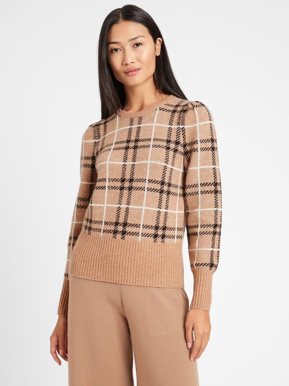 <p>This classic <span>Aire Puff-Sleeve Sweater</span> ($88, originally $99) looks so warm.</p>