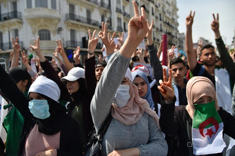 """Thousands of Algerian students protested against the """"system"""" in the capital Algiers on April 23, 2019 (AFP Photo/RYAD KRAMDI                        )"""