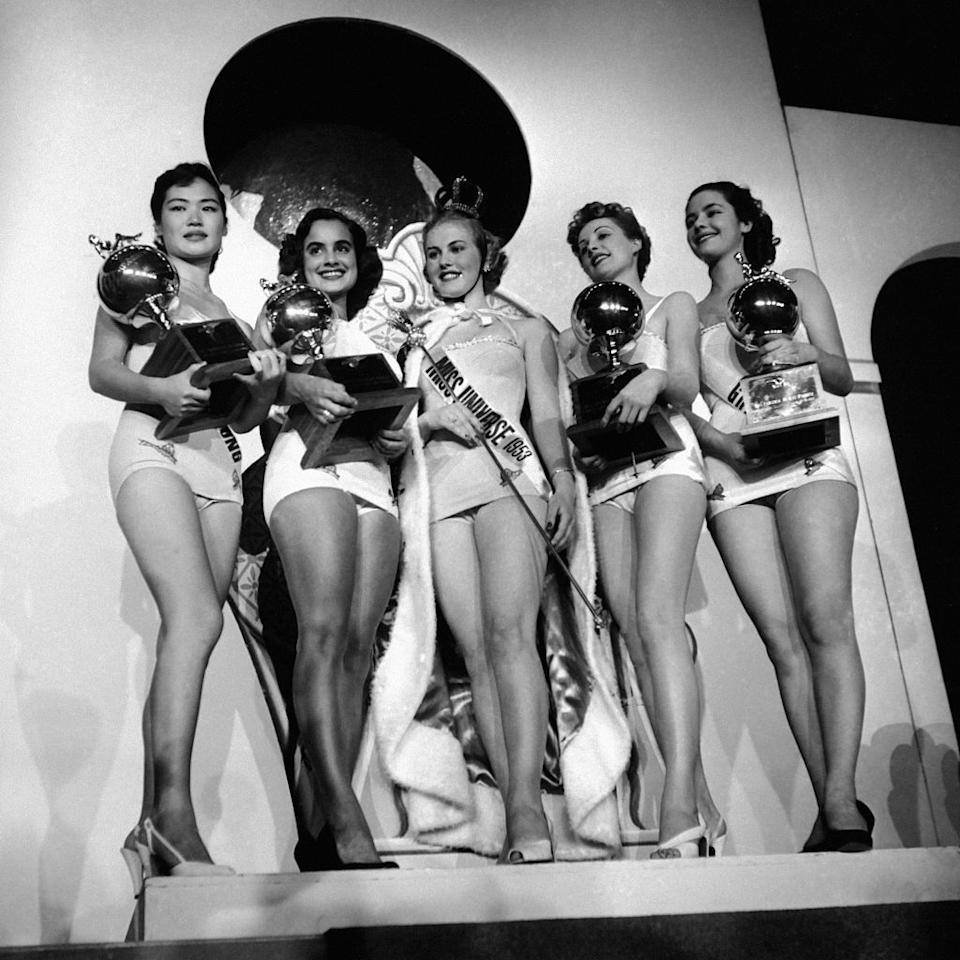 <p>17-year-old Finnish native, Armi Kuusela, center, was the first ever Miss Universe winner. </p>