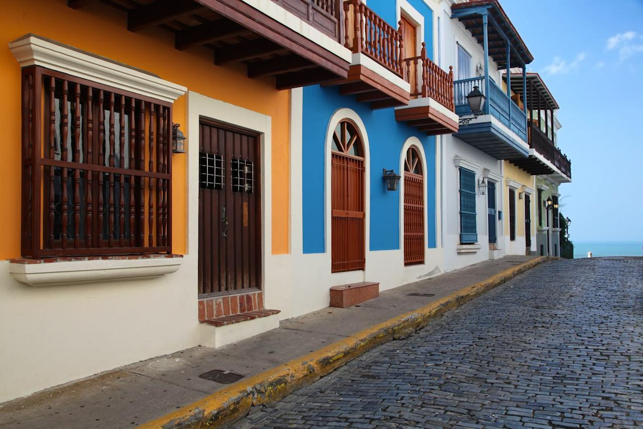 """<p>Depending on where you're flying from, flights to San Juan will cost you as little as <a href=""""https://www.cheapflights.com/flights-to-puerto-rico/"""" target=""""_blank"""">$100 per person</a> right now. Generally, the best time to fly to the island is in January, but February and March are also good months to visit. Check out <a href=""""https://www.tripadvisor.com/Hotel_Review-g1006845-d1984406-Reviews-Hacienda_Siesta_Alegre-Rio_Grande_Puerto_Rico.html"""" target=""""_blank"""">Hacienda Siesta Alegre</a> for a hotel that oozes Puerto Rican culture and affordability. Fly into San Juan and explore historical sites like Old San Juan, Castillo San Felipe del Morro and North America's only rainforest, <a href=""""https://www.harpersbazaar.com/culture/travel-dining/g7171/most-beautiful-places-in-the-world/"""" target=""""_blank"""">El Yunque</a>. </p>"""