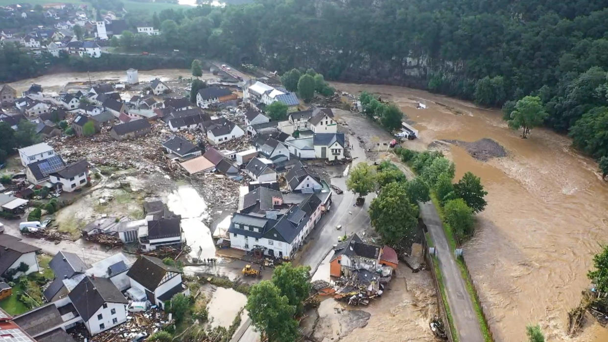 A photo, taken with a drone, shows the devastation caused by the flooding of the Ahr River in the Eifel village of Schuld, western Germany, Thursday, July 15, 2021. At least eight people have died and dozens of people are missing in Germany after heavy flooding turned streams and streets into raging torrents, sweeping away cars and causing some buildings to collapse. (Christoph Reichwein/dpa via AP)