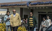 Relatives of passengers who were flying in an EgyptAir plane that vanished from radar en route from Paris to Cairo leave a services hall at Cairo airport on May 19, 2016