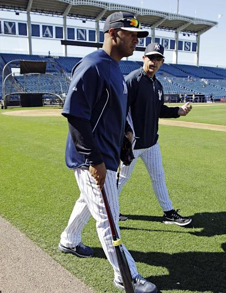 New York Yankees outfielder Vernon Wells takes the field for the first time with third base coach Rob Thomson before a spring training exhibition baseball game against the Houston Astros at Steinbrenner Field in Tampa, Fla., Tuesday, March 26, 2013. Wells' trade to the Yankees was finalized Tuesday, when New York dealt a pair of minor leaguers to the Los Angeles Angels: outfielder Exircado Cayones and left-hander Kramer Sneed. (AP Photo/Kathy Willens)