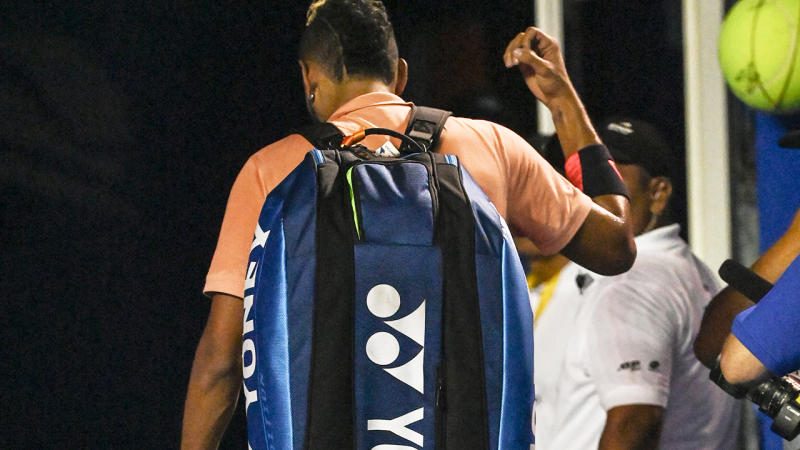 Nick Kyrgios, pictured here leaving the court after retiring hurt.