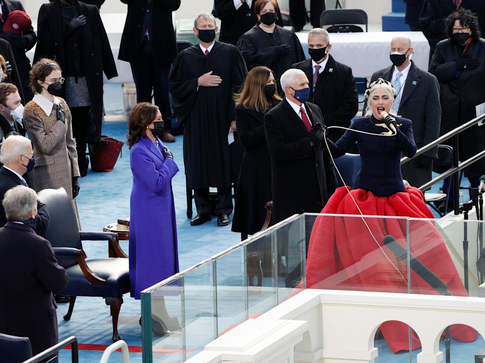 Lady Gaga sings the National Anthem during the inauguration ceremony on the West Front of the Capitol. Ahead of the inauguration on 19 January, Gaga said she hoped the ceremony would be 'a day of peace for all Americans.'REUTERS