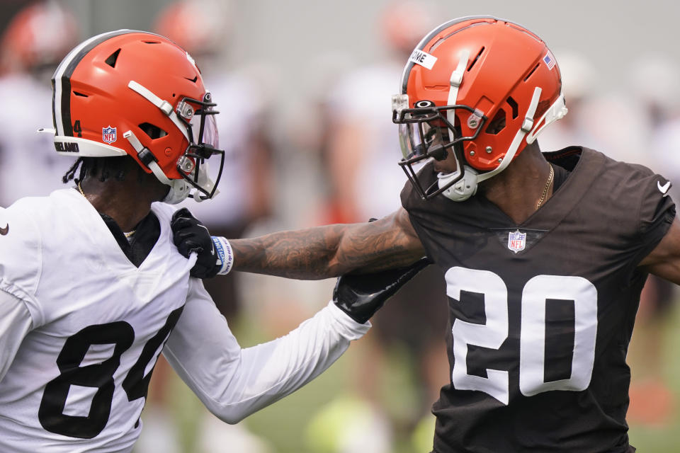 Cleveland Browns cornerback Greg Newsome II (20) and Cleveland Browns wide receiver Ja'Marcus Bradley (84) run a drill during an NFL football practice, Saturday, July 31, 2021, in Berea, Ohio. (AP Photo/Tony Dejak)