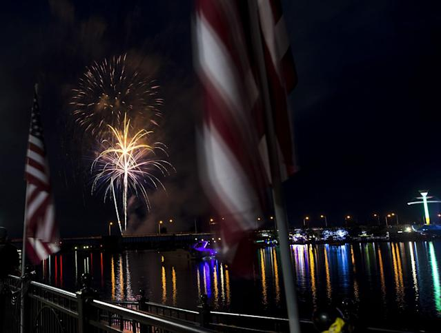 <p>Fireworks explode over the Saginaw River on the second day of the Bay City Fourth of July Festival from Wenonah Park Friday, June 30, 2017, in Bay City, Mich. (Photo: Tori Schneider/The Bay City Times via AP) </p>