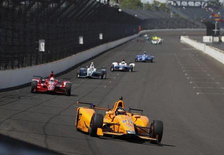 May 22, 2017; Indianapolis, IN, USA; Verizon IndyCar Series driver Fernando Alonso (29) leads a pack of cars down the front straightaway into turn one during practice for the 101st Running of the Indianapolis 500 at Indianapolis Motor Speedway. Mandatory Credit: Brian Spurlock-USA TODAY Sports