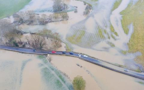 Vehicles attempt to cross a bridge over the River Avon near Lacock - Credit: Lee Thomas