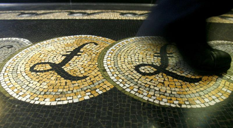 FILE PHOTO: Pound sterling symbols on the floor of the front hall of the Bank of England