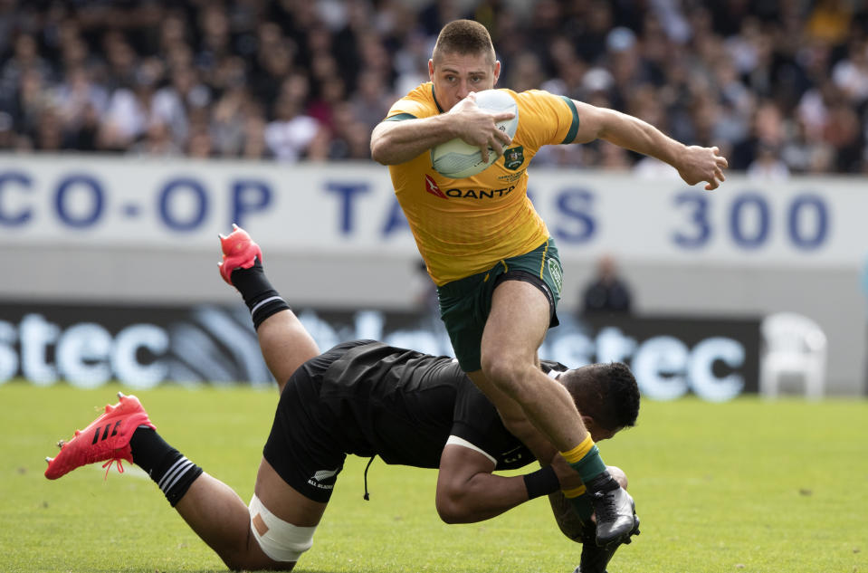 Australia's James O'Connor is tackled by New Zealand's Tupou Vaa'i during the second Bledisloe Rugby test between the All Blacks and the Wallabies at Eden Park in Auckland, New Zealand, Sunday, Oct. 18, 2020. (AP Photo/Mark Baker)