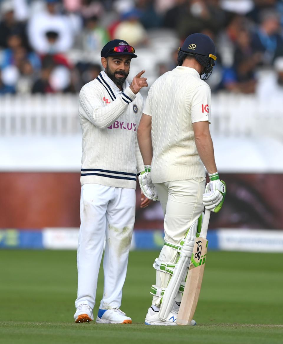 <p>LONDON, ENGLAND - AUGUST 16: India captain Virat Kohli and Jos Buttler have a chat during day five of the second Test Match between England and India at Lord's Cricket Ground on August 16, 2021 in London, England. (Photo by Stu Forster/Getty Images)</p>