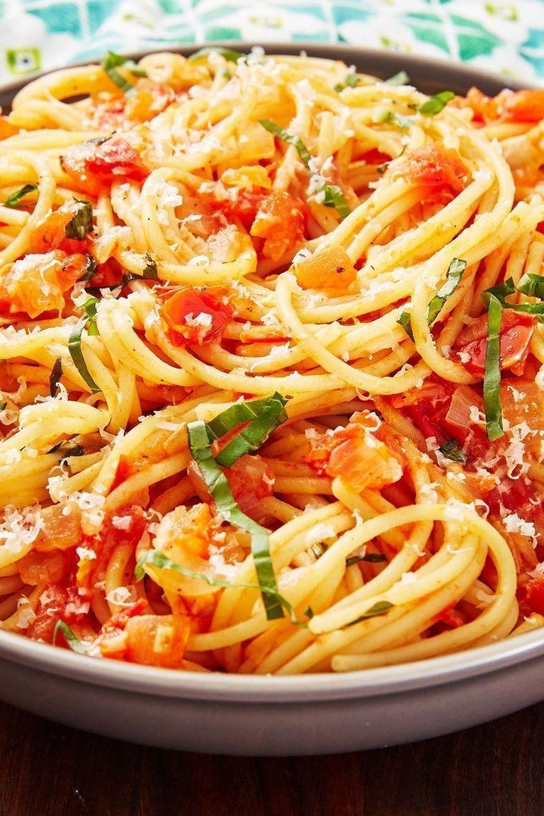 """<p>When it comes to <a href=""""https://www.delish.com/uk/pasta-recipes/"""" rel=""""nofollow noopener"""" target=""""_blank"""" data-ylk=""""slk:pasta"""" class=""""link rapid-noclick-resp"""">pasta</a> we want something simple and fast. Pasta Pomodoro is a step above from <a href=""""https://www.delish.com/uk/cooking/recipes/a28868982/best-spaghetti-and-meatballs-recipe/"""" rel=""""nofollow noopener"""" target=""""_blank"""" data-ylk=""""slk:Spaghetti and Meatballs"""" class=""""link rapid-noclick-resp"""">Spaghetti and Meatballs</a> and highlights the freshness of tomatoes — pomodoro means 'tomato' in Italian. You're cooking down the tomatoes just enough to form a light sauce but keeping most of them intact. It's the freshest pasta and is best enjoyed outside with a mound of grated Parmesan. </p><p>Get the <a href=""""https://www.delish.com/uk/cooking/recipes/a32000915/pasta-pomodoro-recipe/"""" rel=""""nofollow noopener"""" target=""""_blank"""" data-ylk=""""slk:Pasta Pomodoro"""" class=""""link rapid-noclick-resp"""">Pasta Pomodoro</a> recipe.</p>"""