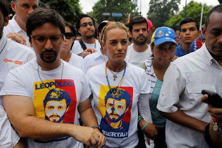 Congressman Freddy Guevara and Lilian Tintori, wife of jailed opposition leader Leopoldo Lopez, take part in a rally to honour victims of violence during a protest against Venezuela's President Nicolas Maduro's government in Caracas