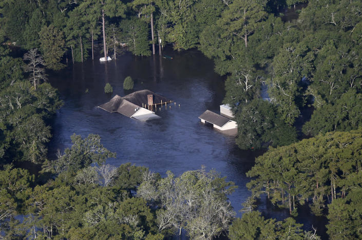 <p>The roofs of homes are seen protruding from floodwaters in the aftermath of Tropical Storm Harvey in Orange, Texas, Thursday, Aug. 31, 2017. (Photo: Gerald Herbert/AP) </p>