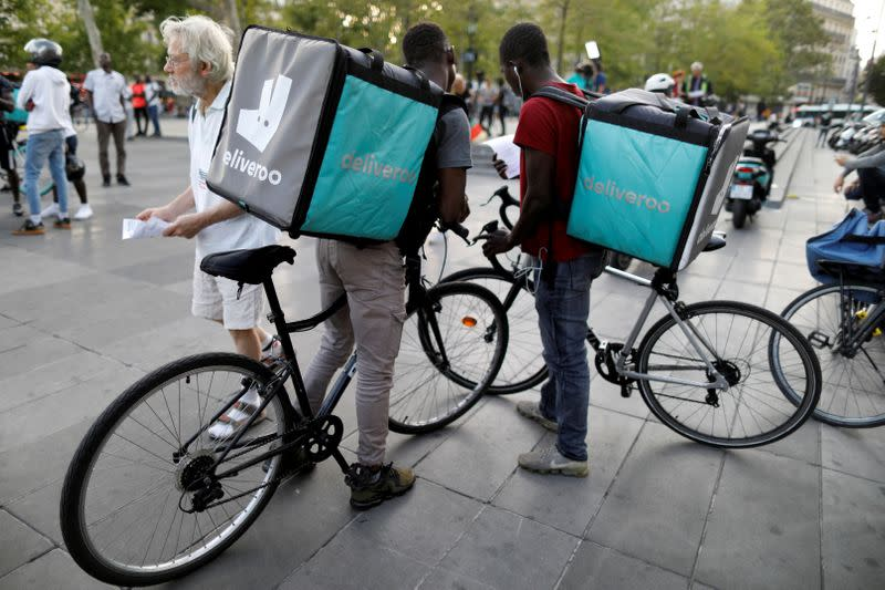 FILE PHOTO: Bikers of food courier service Deliveroo demonstrate as they called on clients to boycott the brand in Paris