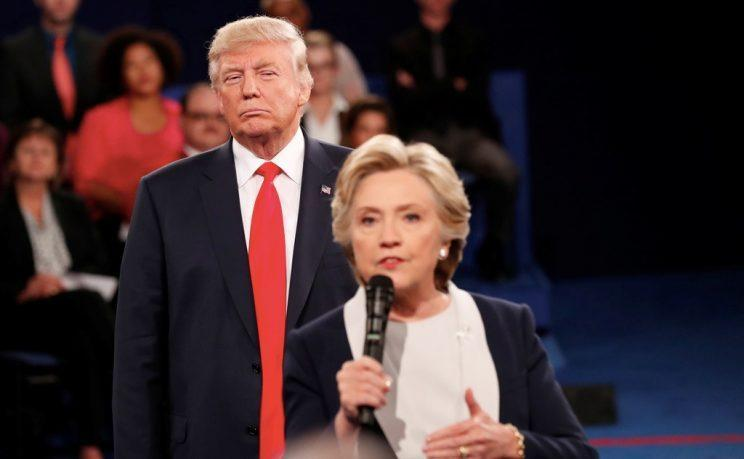 Donald Trump listens as Hillary Clinton answers a question during the second presidential debate. (Photo: Rick Wilking/Reuters)