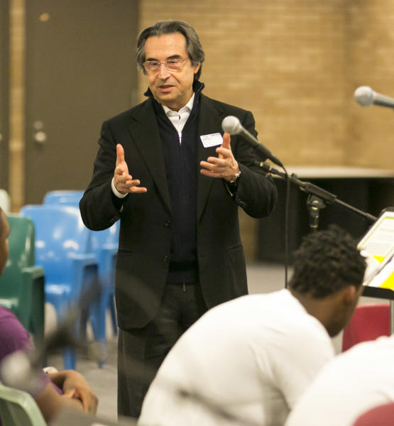 Chicago Symphony Orchestra Music Director Riccardo Muti talks to Cook County Juvenile Detention Center inmates following their music performance as part of the CSO's Citizen Musician program which brings music to a variety of locations including prisons, Sunday, April 14, 2013. (AP Photo/Todd Rosenberg)