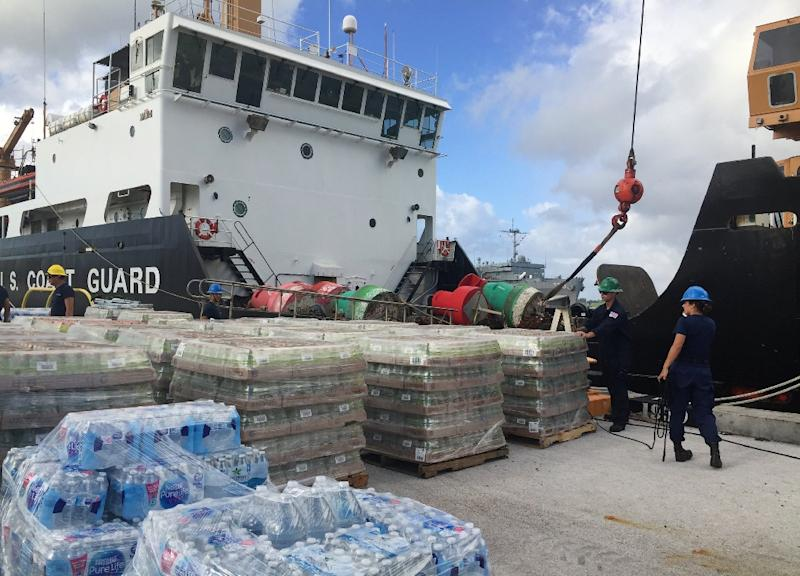 Various US supplies being loaded onto a ship in Guam before setting sail to Saipan in the Northern Mariana Islands to help those affected by Super Typhoon Yutu