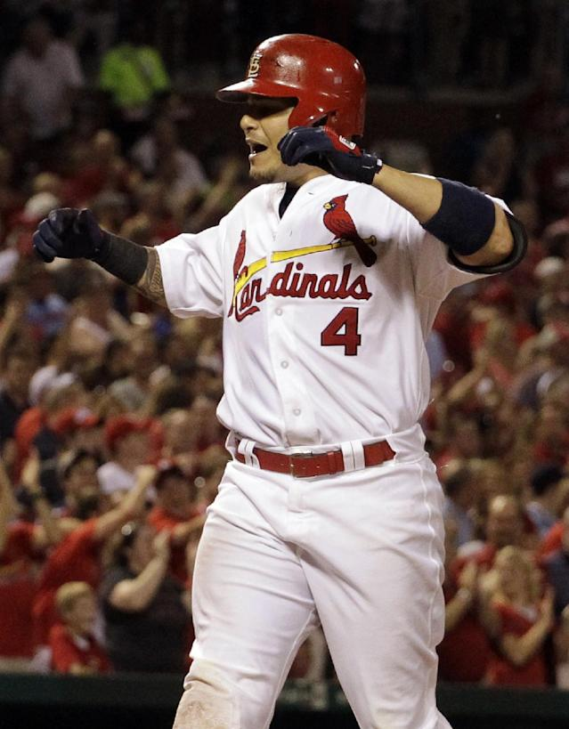 St. Louis Cardinals' Yadier Molina celebrates as he reaches home after hitting a two-run home run during the sixth inning of a baseball game against the Chicago Cubs, Wednesday, June 19, 2013, in St. Louis. (AP Photo/Jeff Roberson)