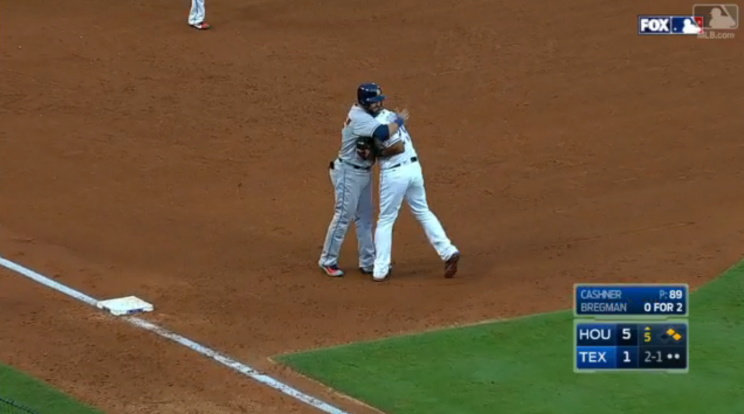Adrian Beltre and Carlos Beltran hug during Saturday's game. (Screenshot via MLB.com)