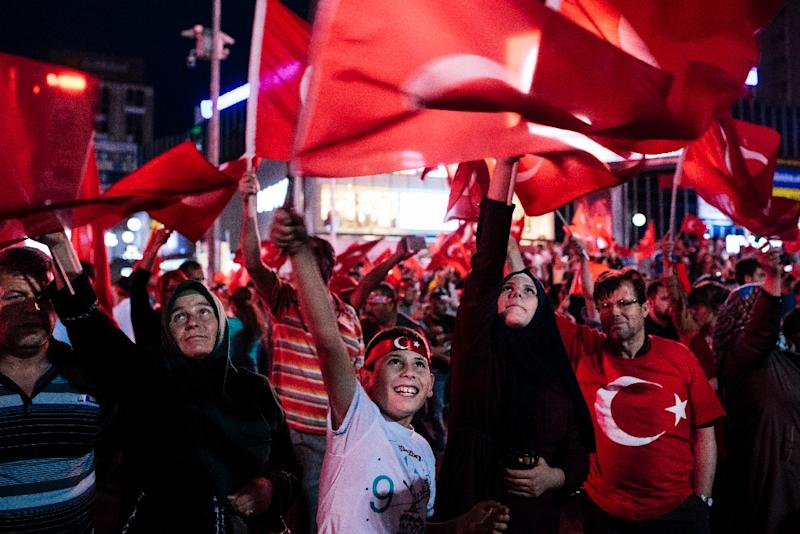 Pro Erdogan supporters wave Turkish flags during a rally at Kizilay Square in Ankara on July 20, 2016