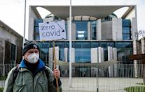A demonstrator from the pro-lockdown Zero Covid movement outside the German Chancellery