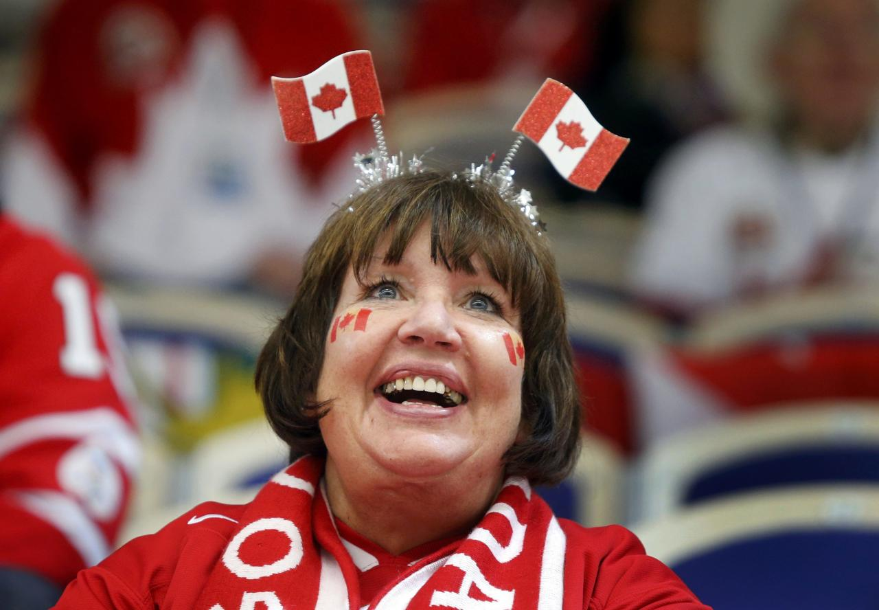 A Canada supporter smiles during a break in play against Germany of their IIHF World Junior Championship ice hockey game in Malmo, Sweden, December 26, 2013. REUTERS/Alexander Demianchuk (SWEDEN - Tags: SPORT ICE HOCKEY)