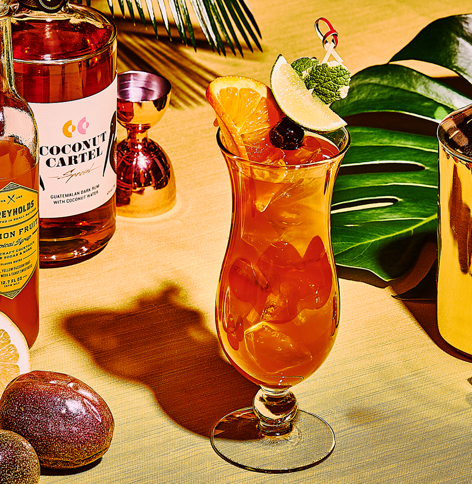 """<p><em>This drink was meant to be downed while wandering the French Quarter. But your backyard will work in a pinch.</em></p><p><strong>Ingredients</strong></p><p>• 2 oz. dark rum<br>• 1 oz. passion fruit syrup<br>• 1 oz. fresh lemon juice<br>• orange slices<br>• maraschino cherries </p><p><strong>Directions</strong></p><p>Combine rum, passion fruit syrup, and lemon juice with ice in a shaker. Shake until frosty. Pour into a hurricane glass filled with more ice cubes. Garnish with orange slices and maraschino cherries.</p><p><a class=""""link rapid-noclick-resp"""" href=""""https://www.esquire.com/food-drink/drinks/a27667205/hurricane-cocktail-drink-recipe/"""" rel=""""nofollow noopener"""" target=""""_blank"""" data-ylk=""""slk:Read More"""">Read More</a></p>"""