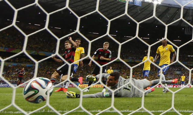 Germany's Toni Kroos (18) scores a goal during their 2014 World Cup semi-finals against Brazil at the Mineirao stadium in Belo Horizonte July 8, 2014. REUTERS/Eddie Keogh (BRAZIL - Tags: SOCCER SPORT WORLD CUP)
