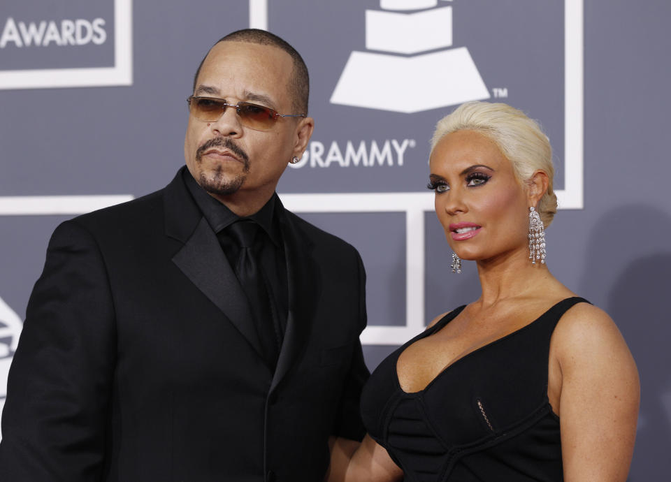 Ice-T and his wife Coco arrive at the 54th annual Grammy Awards in Los Angeles, California February 12, 2012.  REUTERS/Danny Moloshok   (UNITED STATES) (GRAMMYS-ARRIVALS)