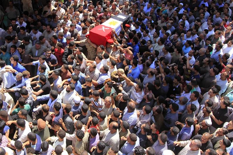 Egyptians carry the coffin of First Lieutenant Mohamed Ashraf, killed in clashes with Islamic State group jihadists in the Sinai, during his funeral in Ashmoun in the Nile delta on June 2, 2015