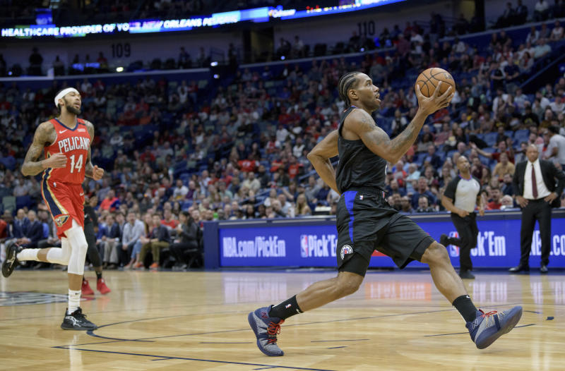 Los Angeles Clippers forward Kawhi Leonard (2) breaks free for an easy basket against New Orleans Pelicans forward Brandon Ingram (14) in the first half an NBA basketball game in New Orleans, Saturday, Jan. 18, 2020. (AP Photo/Matthew Hinton)