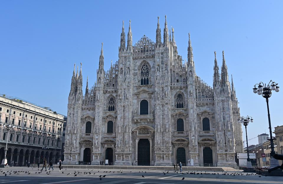 A picture shows a general view of an almost empty Piazza del Duomo in center Milan on November 7, 2020.