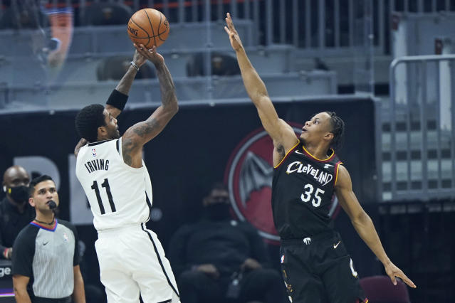 Irving returns, but new-look Nets beaten by Cavs in 2 OTs