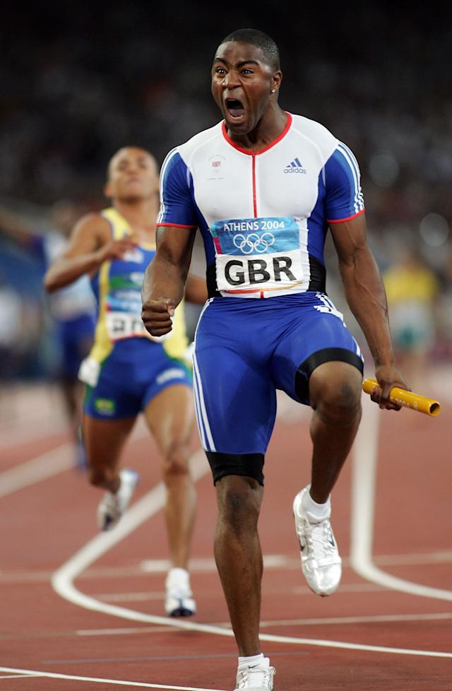 ATHENS - AUGUST 28: Mark Lewis-Francis of Great Britain celebrates after Great Britain won the men's 4 x 100 metre relay final on August 28, 2004 during the Athens 2004 Summer Olympic Games at the Olympic Stadium in the Sports Complex in Athens, Greece. (Photo by Michael Steele/Getty Images)