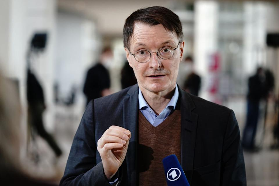 24 March 2021, Berlin: Karl Lauterbach, health expert of the SPD, gives an interview after Chancellor Merkel (CDU) answered the questions of the members of the Bundestag during the government questioning in the Bundestag. A main topic is the Easter and lockdown decisions of the federal-state conference on the Corona pandemic. Photo: Kay Nietfeld/dpa (Photo by Kay Nietfeld/picture alliance via Getty Images)